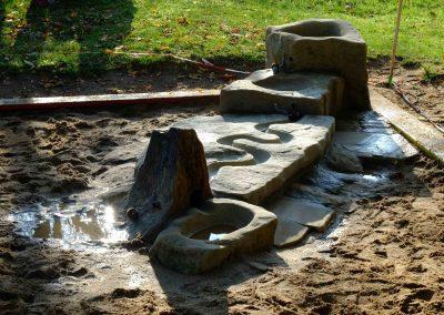 erweiterung des Sandkastens mit einer kleinen Wasserspielanlage
